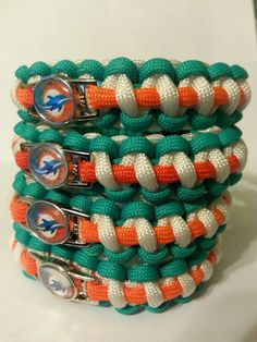 My boys would love these!Charmed Miami Dolphins Survival Bracelets