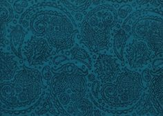 """The mostluxurious wrap from Ellevill in 50 %silk and 50 % organic cotton. Two colored inblue/teal and black. So supersoft!Paisley pattern is a droplet-shaped vegetable motif of Indian and Persian origin, similar to half of the Yin yang symbol. The pattern is sometimes called """"Persian pickles"""" by American traditionalists, especially quiltmakersas far back as 1888.In Sanskrit the design is known as mankolam and has long been used in India. It resembles a mango and has sometimes been…"""