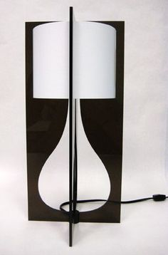 Tucker Waugh's laser cut table lamp. EWF Modern carries these in Portland. #lasercut #lamp #acrylic