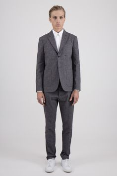 Formal outfit from Uniforms For The Dedicated with a grey twill suit and white sneakers