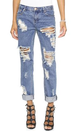 Slightly faded and heavily distressed - a rock n roll slouchy denim look