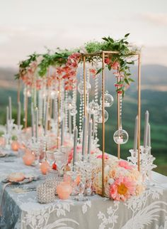 Beautiful peach top table styling with golden frames and hanging tea light baubles #piecesandposies