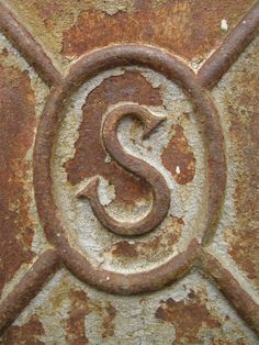 Rusty logo on a metal plate set into a concrete wall. Seaside, OR, August Rusty letter S Abc Letra, Rust Never Sleeps, Alphabet Photography, Rust In Peace, Peeling Paint, Alphabet And Numbers, Alphabet Names, Rusty Metal, Typography