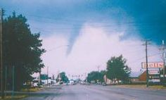 The 1987 Cheektowaga tornado moves south on Union Road, headed toward the Holiday Showcase restaurant. Below, photos show the damage the twister caused to residential neighborhoods on George Urban Boulevard, Miami Parkway and Cherokee Drive.  Photos courtesy of the Town of Cheektowaga