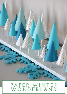 Easy Mantel Idea: Colorful Paper Tree Forest Learn how to make a folded paper tree forest for your holiday mantel! The post Easy Mantel Idea: Colorful Paper Tree Forest appeared first on Do It Yourself Fashion. Winter Wonderland Decorations, Winter Wonderland Birthday, Paper Christmas Decorations, Winter Wonderland Christmas, Christmas Tree Crafts, Noel Christmas, Christmas Birthday, Winter Party Decorations, Christmas Paper