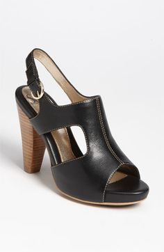 """Alluring cutouts lend architectural interest to an open-toe slingback lifted with a blocky stacked heel.        Adjustable strap with buckle closure.      Approx. heel height: 3 1/2"""" with 1/2"""" platform (comparable to a 3"""" heel).      Leather upper and lining/synthetic sole.      By Söfft; imported.      Women's Shoes."""
