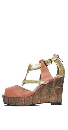 6848d79ff4f Crafted in soft vegan leather and vaunting a lofty cork wedge