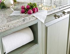 Somehow this niche that keeps paper towels out of sight (but still easily accessible) is so much more chic than when it hangs from your cabinet or sits on your counter.    - HouseBeautiful.com