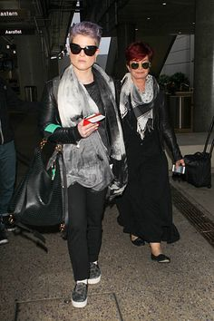 Like mother, like daughter. A color-coordinated Kelly Osbourne and Sharon Osbourne arrive at the Los Angeles International Airport on June 11