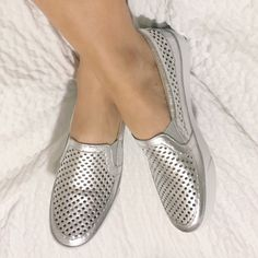 HPNine West metallic silver Brodie slip on's Like new Nine West metallic silver Brodie slip on sneakers with white bottoms. Size 5.5. Great for spring. Nine West Shoes Flats & Loafers