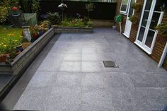The Marks' Granite patio, using #silver grey and blue-black #granite #paving from Nustone!