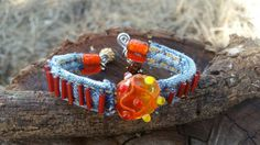 Check out this item in my Etsy shop https://www.etsy.com/listing/463282911/denim-bracelet-with-lampwork-bead-and