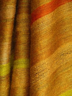Gold striped mohair blanket with a touch of tangerine