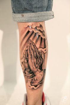 Back of leg praying hands tattoo.