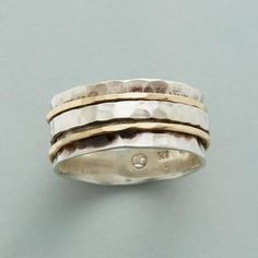 Perfect Partners Ring - A hand-hammered silver & gold partners ring, with bands of sterling silver and 14kt gold blend beautifully in this distinctive ring with character galore. Exclusive. Whole sizes 5 to 9. This ring is licensed under U.S. patent nos. 6,497,117 and 6,395,732.