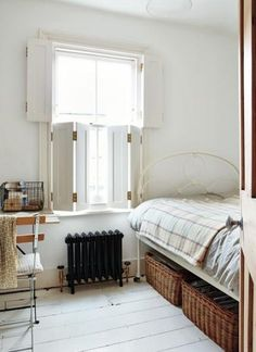 10 Favorites: Serene Guest Bedrooms Sara Emslie's House in Beautifully Small, Photos by Rachel Whiting, Under bed basket storage in guest room Interior Window Shutters, Interior Windows, Bedroom Shutters, Wooden Shutters, Indoor Shutters For Windows, Window Shutters Inside, White Shutters, Window Bed, Bay Windows