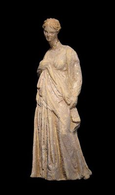 Tanagra figure of a lady Greece, c. 4th-3rd century BC.