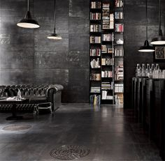 Industrial interiors feature fixtures or materials that are often seen in a warehouse or factory setting such as exposed pipes, wires, metal, or brick. Many lofts are former industrial buildings and so highlighting these particular characteristics compliments an already distinctive living space.