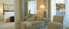 The richly detailed suites at The Ritz-Carlton, Fort Lauderdale whisper of 1940's era with a palate of ecru and white, black-and-white photos and an overall elegant sophistication.