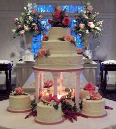 This cake is the right shape. The pink pillars should be white and the little satellite cakes are unnecessary. I like the three tiers on the top though and how the cake fully covers the cake board. Bling Wedding Cakes, Purple Wedding Cakes, Wedding Cake Stands, Elegant Wedding Cakes, Beautiful Wedding Cakes, Wedding Cake Designs, Beautiful Cakes, Elegant Cakes, Wedding Cupcakes
