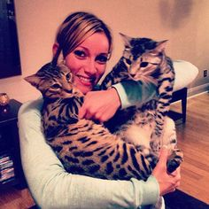 Jeana home with her cats.