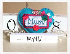 A personal favorite from my Etsy shop https://www.etsy.com/uk/listing/273553972/mothers-day-hanging-felt-heart