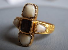 Memento Mori:  Unusual Victorian braided hair and milk teeth gold mourning ring.