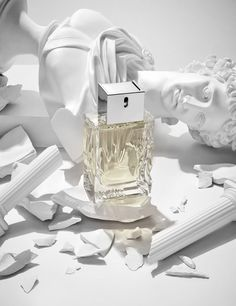 Fragrance bottle and smashed greek statues shot by London based still life photographer Josh Caudwell. Creative commercial editorial photography using roman statues and perfumes.