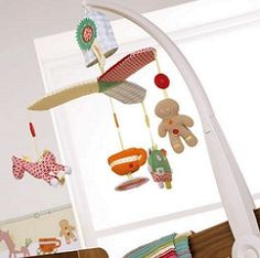Gingerbread Musical Mobile - $119.95 - A bright colourful cot mobile to co-ordinate with the Gingerbread interiors range A musical mobile designed to keep your baby entertained, or soothe them to sleep #sweetcreations #baby #nursery #mobile #gingerbread #babyshower #gifts