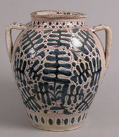 This is so beautiful!  Two-Handled Jar Date: early 15th century Geography: Made in Florence, Tuscany, Italy Culture: Italian Medium: Tin-glazed earthenware Dimensions: Overall: 14 3/8 x 13 x 11 3/4 in. (36.5 x 33 x 29.9 cm)