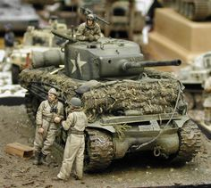 A Sherman Tank crew awaits orders to move...