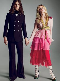 Gucci - Michele's lush, extravagant, and wildly colored–and–patterned collections have struck a chord with a generation barely born when Ford reinvigorated the house. On Georgia May Jagger: Gucci chiffon-crépon dress and boots. On musician Garrett Borns, who performs as Børns: Gucci suit, shirt, neck bow, and loafers. All at select Gucci boutiques.  Fashion Editor: Camilla Nickerson Hair: Christiaan; Makeup: Aaron de Mey
