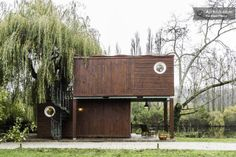 A modern cabin made of repurposed shipping containers is found along the banks of the Seine in Paris.
