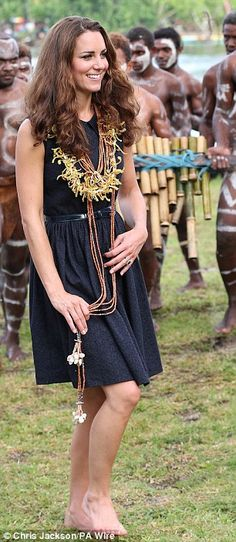 The Duchess joins in with the local dancers in a navy blue dress from Mulberry - Solomon Islands