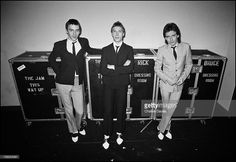 British new wave group The Jam pose with their individual wardrobe flight cases backstage at the Gaumont, Southampton, during their British tour, 24th November 1979.