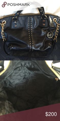 Michael Kors black ang gold purse. Authentic. Gorgeous Mk purse. Hardly used. Excellent condition. Comes with long strap. Clean inside and out. Michael Kors Bags Satchels