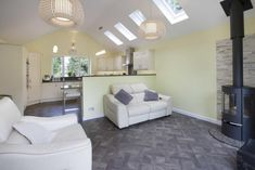 Kitchen family room with vaulted ceiling, log burner stove and Velux windows. Furniture, Room, Family Room, Home, Kitchen Family Rooms, Log Burner, Velux Windows, Architectural Services, Kitchen Extension