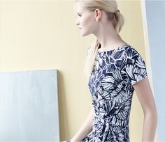 A knit floral sundress and a ponytail, instant summer chic.