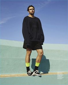 Embracing the oversized trend, Jack Tyerman wears a sweater and shorts from Dries Van Noten. Jack also sports Loewe socks and Vans sneakers.