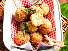 Crispy arancini balls recipe - By Woman's Day, These golden mouthfuls are crispy on the outside and fluffy on the inside with rice and oozing melted cheese. The perfect snack or meal! Rice Recipes, Vegetarian Recipes, Cooking Recipes, Savoury Recipes, How To Make Arancini, Veggie Delight, Tasty, Yummy Food, Balls Recipe