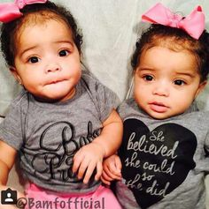 These twin girls are beautiful and I love their tops!