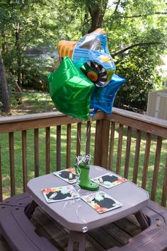 Kids table: picnic table with balloons and chalkboards