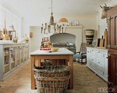 Fabulous Farmhouse Kitchens  A trending style in natural elements I like the use of glass base cabinets