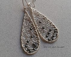 Silver teardrop earrings with hematite beads by Harsh and Sweet