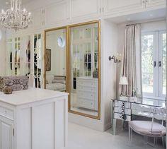 Closet doors using pair of gilt wood antique French mirrored doors .