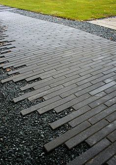 torn edge on paver pathway - bricks fading into gravel