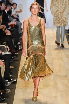 The Color:   Golden Child  Designers envisioned a gilded fall, rich with sequins, paillettes, and glittered sheen.