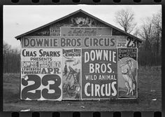 W. Evans. Downie Bros. Circus Posters on Building. 1936.