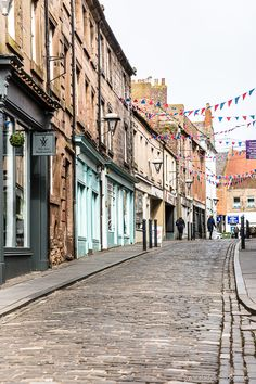 West Street is a pretty cobblestone lane with bunting in Berwick-upon-Tweed, Northumberland, England. Cool Places To Visit, Places To Travel, Travel Destinations, Northumberland Coast, Berwick Upon Tweed, Visit Uk, Places In England, Scotland Travel, Scotland Vacation