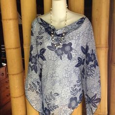 Flowy cool top Size L Flowy cool top size L. Asymmetrical hem line, pretty blues and hangs off your shoulder a bit. Wear with a white top underneath because material is sort of see through. New w tag Merona Tops